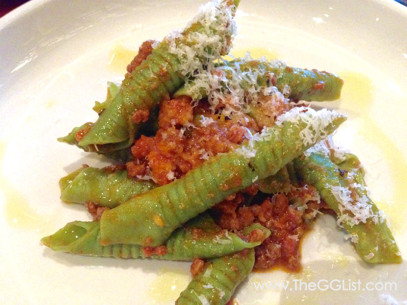 Spinach garganelli with Ragu sauce from Modena.